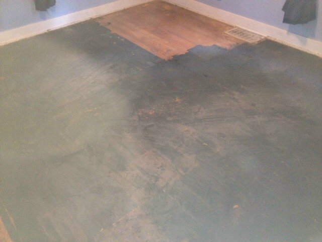 a hardwood floor that appears to have stains from a dark substance