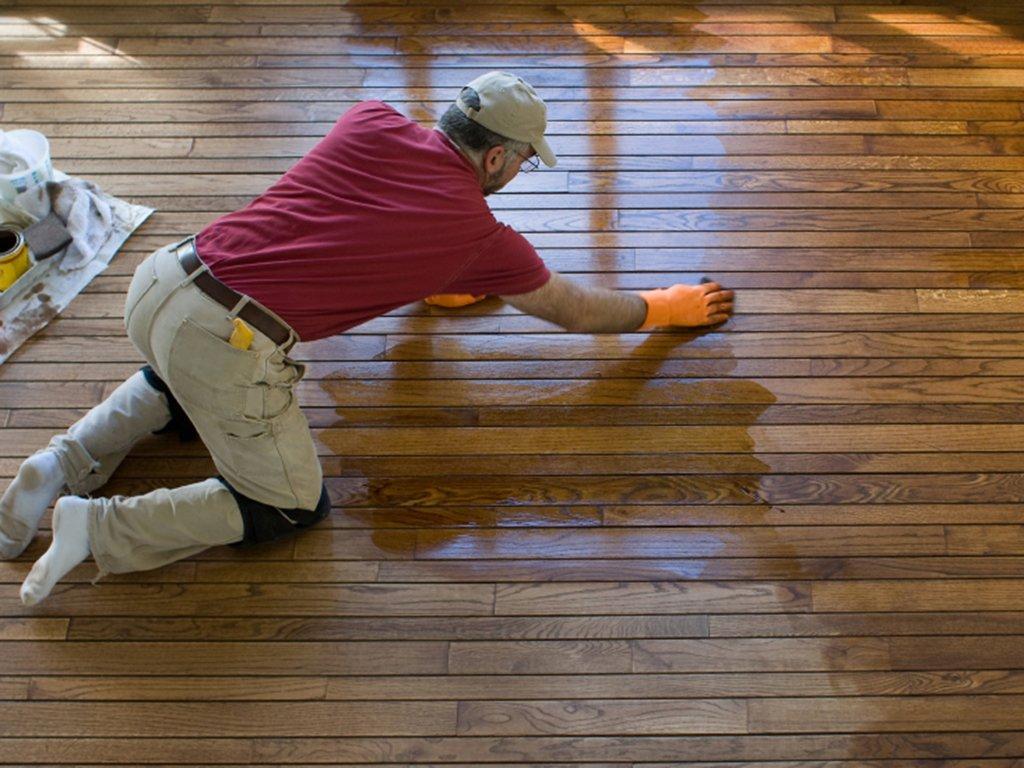 a chula vista floor refinisher hard at work updating a wood floor.