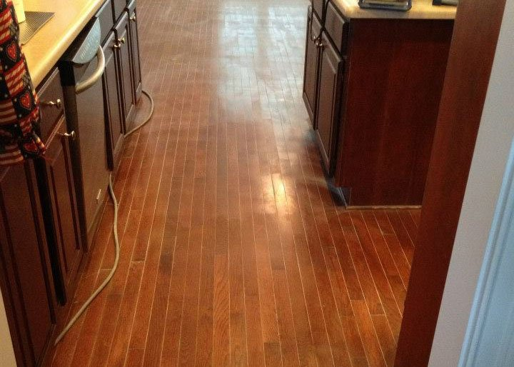 a wood floor in need of some maintenance