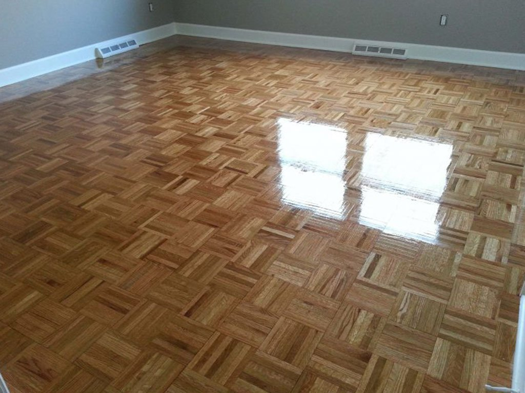 A recently refinished parquet wood floor