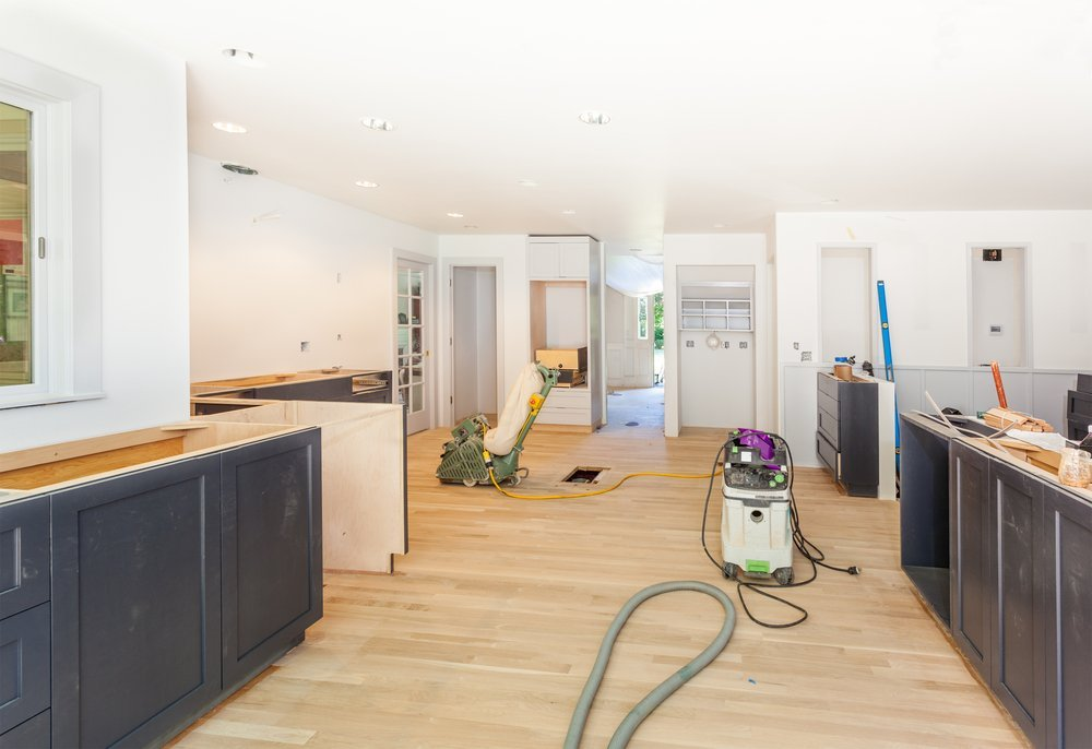The refinishing tools and equipment are seen at work on a wood floor